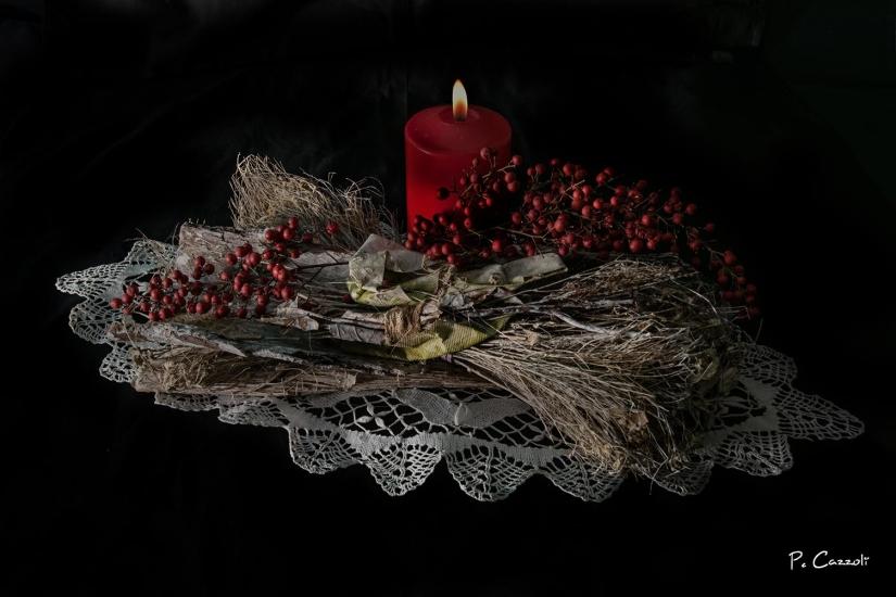Centro tavola con candela accesa