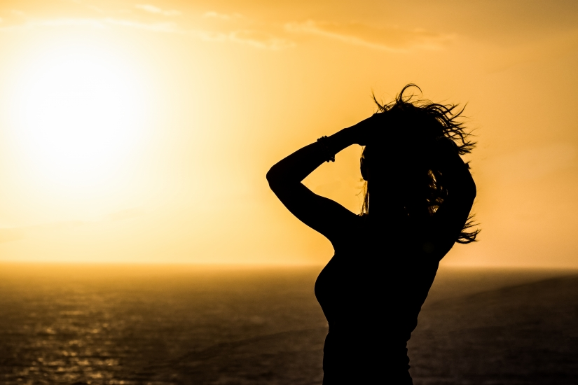 Lady On The Sunset