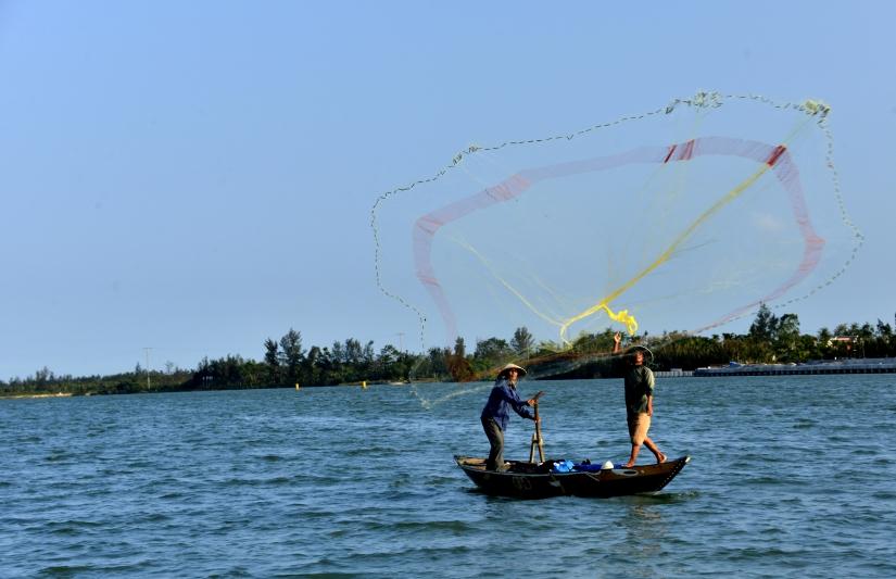Pescatori nel Delta del Mekong