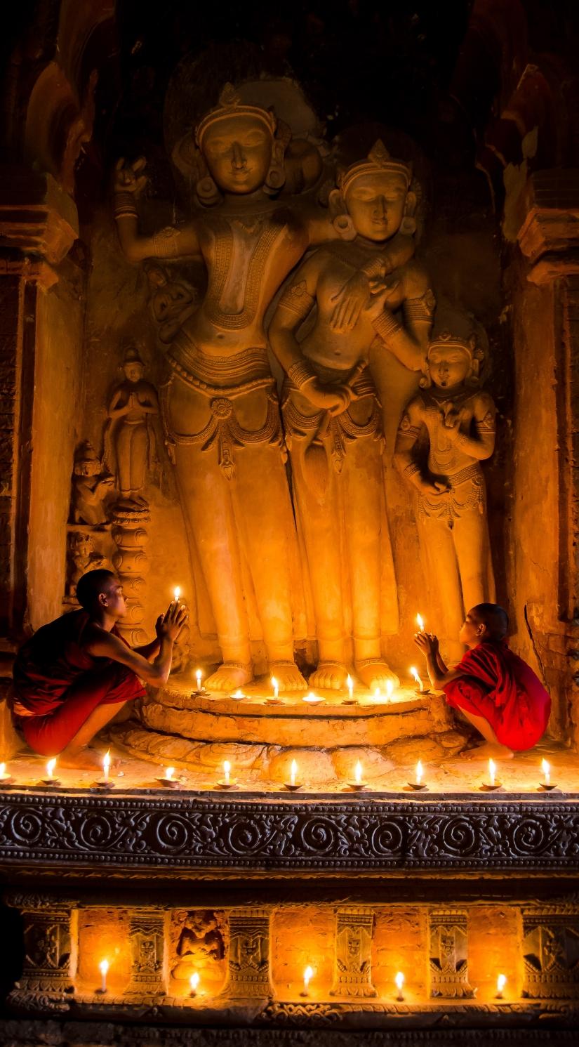 Praying at candle light